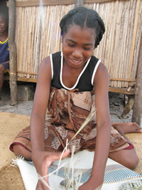 Madagascar weaver preparing Blessing Basket purse